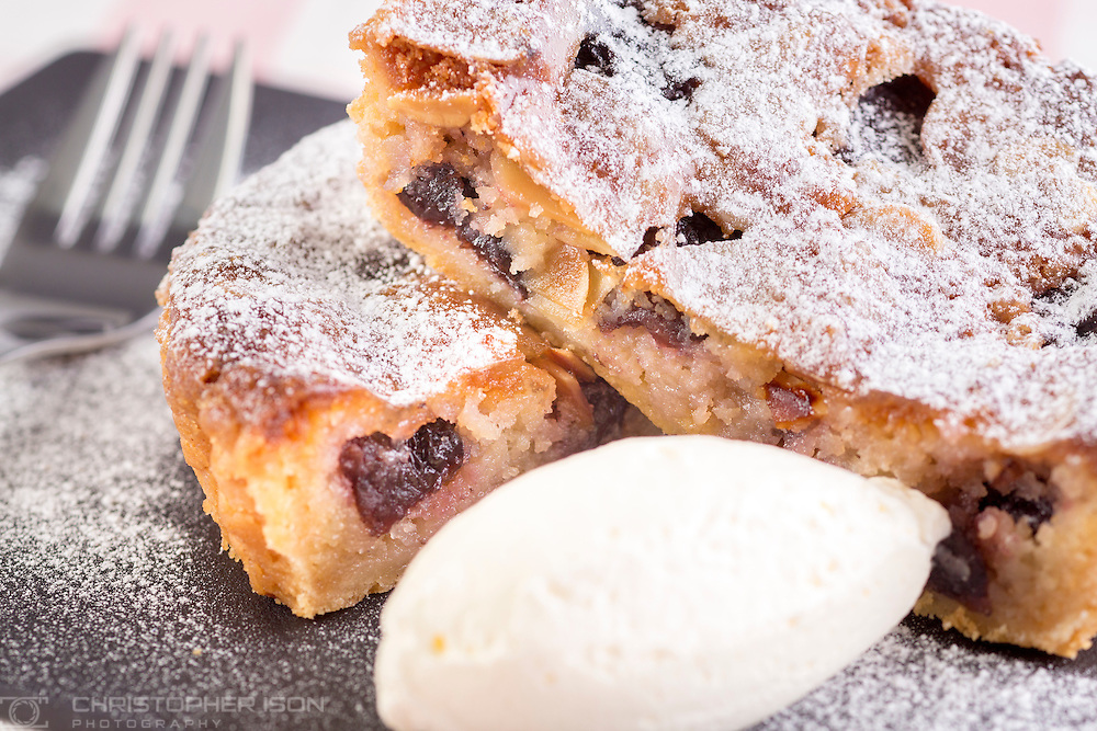 Warm Black Cherry Bakewell Tart with Clotted Cream Ice Cream pictured at P&amp;O Cruises Development Kitchen for the Macmillan Cancer Support cookery book.<br /> Picture date: Friday April 29, 2016.<br /> Photograph by Christopher Ison &copy;<br /> 07544044177<br /> chris@christopherison.com<br /> www.christopherison.com