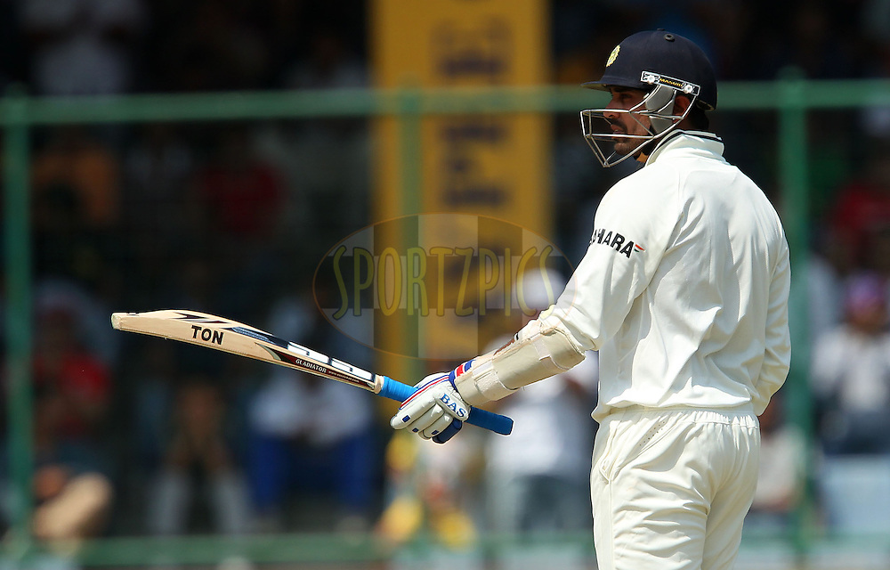 Murali Vijay of India raises his bat to celebrate his fifty during day 2 of the 4th Test Match between India and Australia held at the Feroz Shah Kotla stadium in Delhi on the 23rd March 2013..Photo by Ron Gaunt/BCCI/SPORTZPICS ..Use of this image is subject to the terms and conditions as outlined by the BCCI. These terms can be found by following this link:..http://www.sportzpics.co.za/image/I0000SoRagM2cIEc