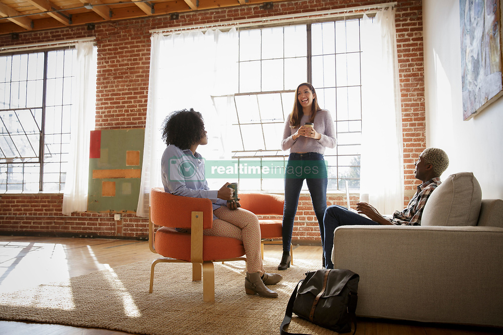 February 24, 2017 - Three colleagues, in new office space, having discussion (Credit Image: © Image Source via ZUMA Press)