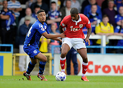 Bristol City's Mark Little is challenged by Rochdale's Bastien Hery - Photo mandatory by-line: Dougie Allward/JMP - Mobile: 07966 386802 23/08/2014 - SPORT - FOOTBALL - Manchester - Spotland Stadium - Rochdale AFC v Bristol City - Sky Bet League One