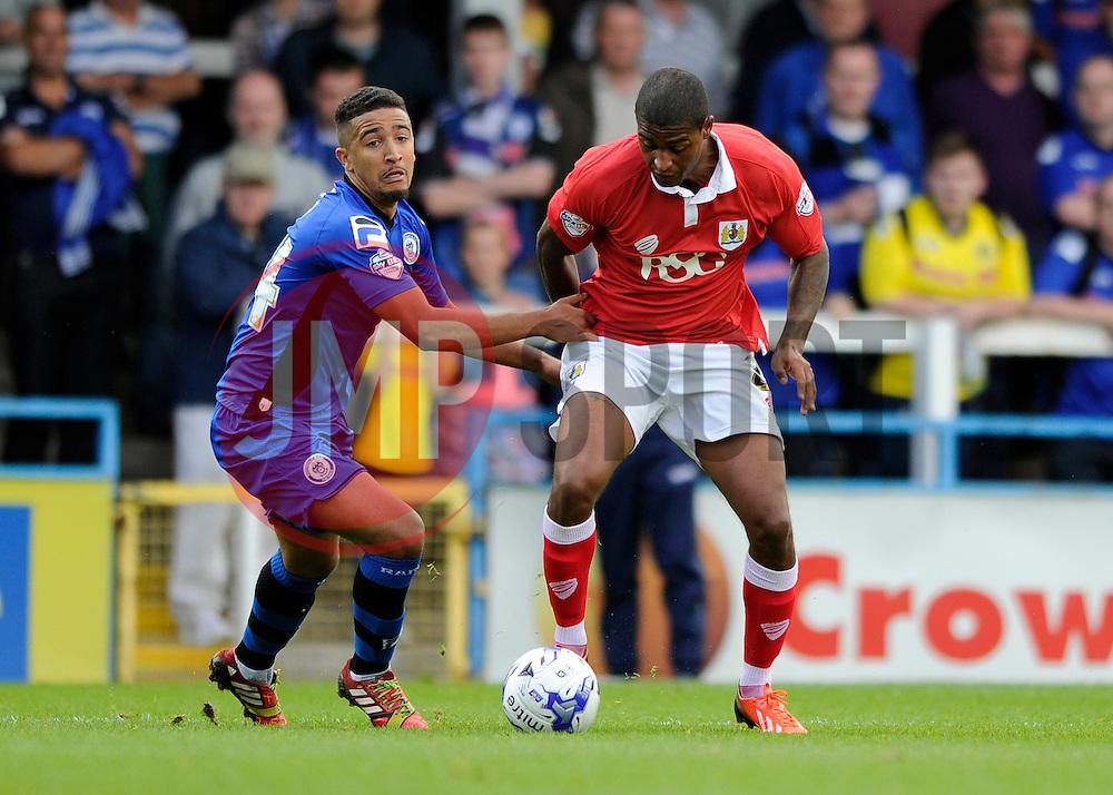 Bristol City's Mark Little is challenged by Rochdale's Bastien Hery - Photo mandatory by-line: Dougie Allward/JMP - Mobile: 07966 386802 23/08/2014 - SPORT - FOOTBALL - Manchester - Spotland Stadium - Rochdale AFC v Bristol City - Sky Bet League One