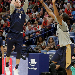 Oct 5, 2019; New Orleans, LA, USA; New Orleans Pelicans guard JJ Redick (4) shoots over guard E'Twaun Moore (55) during a open practice at the Smoothie King Center. Mandatory Credit: Derick E. Hingle-USA TODAY Sports
