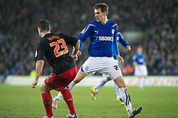 CARDIFF, WALES - Tuesday, February 1, 2011: Cardiff City's Aaron Ramsey and Reading's Ian Harte during the Football League Championship match at the Cardiff City Stadium. (Photo by Gareth Davies/Propaganda)