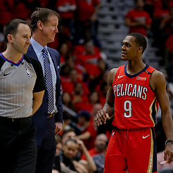 Apr 21, 2018; New Orleans, LA, USA; Portland Trail Blazers head coach Terry Stotts and New Orleans Pelicans guard Rajon Rondo (9) during the fourth quarter in game four of the first round of the 2018 NBA Playoffs at the Smoothie King Center.  Pelicans defeated the Trail Blazers 131-123 sweeping the series and advancing to the western conference semi-finals.  Mandatory Credit: Derick E. Hingle-USA TODAY Sports