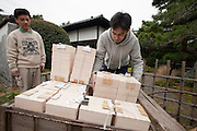 Nakazato Taroemon kiln (3-6-29 Machida, Karatsu; +81-955-72-8171), located a five minute walk from the train station. The 14th successor--in an unbroken lineage--plies his trade here along with a large staff of over twenty. Situated within a Japanese bonsai garden, the time-honoured spot also features a small shop connected to a museum by a simple wooden bridge.preparing finished pieces for shipment to clients.