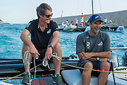 Emirates Team New Zealand. Richard Meacham and Jeremey Lomas having a laugh on the tow back to port after racing. Day two of the Extreme Sailing Series at Nice. 3/10/2014