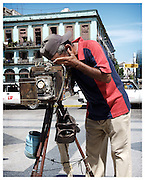 Portrait photographer with vintage large format camera, Havana, Cuba.