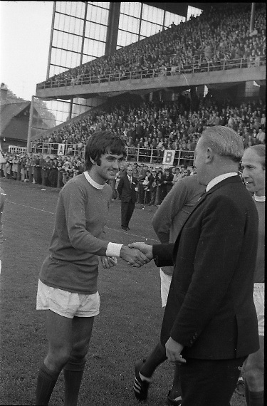 Waterford FC vs Manchester United at Lansdowne Road..1968..18.09.1968..09.18.1968..18th September 1968..Waterford FC as champions of the league of Ireland drew Manchester United, the European Champions,in the first round of this years competition.The Waterford team was as follows: Peter Thomas, Peter Bryan, Noel Griffin, Vinny Maguire, Jackie Morley, Jimmy McGeough, Al Casey, Alfie Hale, John O'Neill, Shamie Coad and Johnny Matthews. Manchester United won the tie 3 -1 with Denis Law being the man of the match..Alex Stepney,Tony Dunne,Francis Burns,Paddy Crerand,.Bill Foulkes,Nobby Stiles,George Best,Denis Law,.Bobby Charlton,David Sadler,Brian Kidd were the starting eleven for United...Image shows George Best being introduced in the pre-match presentation.