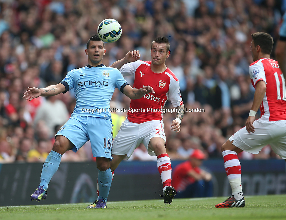 13 September 2014 , Premier League ,  Football Arsenal v Manchester City - Sergio Aguero of City shields the ball from Mathieu Debuchy.<br /> Photo: Mark Leech