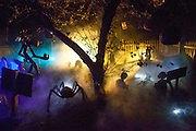 "Fog lifts over Chris Baker's haunted yard in South Yarmouth, MA. Every year Baker sets up an elaborate Halloween display in his yard and on Halloween, neighborohood residents walk through his frightening ""vortex"" of horror while trick or treating."