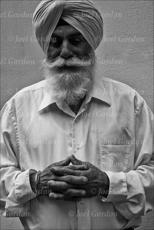 Sikh-American chanting and praying showing his religious devotion and ethnic pride before the start of the Sikh Day Parade in New York City.