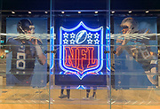 Oct 19, 2018; London, United Kingdom; General overall view of display with neon NFL shield logo and signage of Tennessee Titans quarterback Marcus Mariota (8) and Los Angeles Chargers cornerback Casey Hayward (26) at Niketown London.