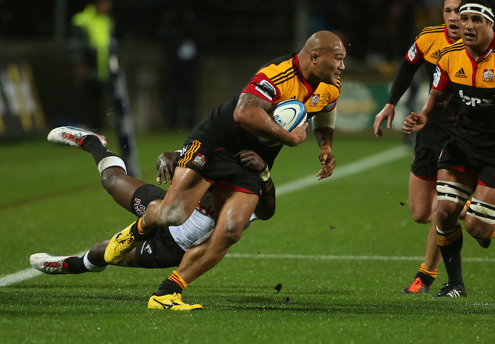Chief's Sona Taumalolo is caught in the tackle of Shark's JP Pietersen in the Super 15 Rugby final match, Waikato Stadium, New Zealand, Saturday, August 04, 2012. Credit:SNPA / John Cowpland