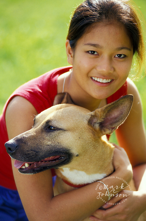 Australia, Qld., portrait of teenage girl & pet dog