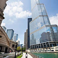 Photo of Chicago downtown Riverwalk sidewalk along the Chicago River in downtown Chicago with Leo Burnett Building, United Airlines Building, Trump Tower, Marina City Towers, and IBM Building.