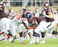 Mississippi Rebels defensive lineman Bryon Bennett (95) tackles Texas A&M Aggies quarterback Kenny Hill (7) for a loss in College Station, Texas on Saturday, October 11, 2014.