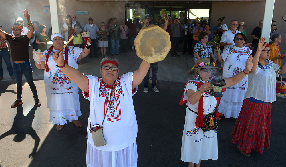 gbs051517a/ASEC -- Rev. Virginia Rincon of Albuquerque , center with drum, says an involcation during the 5th Annual El Camino Real Garden Blessing at the Barelas Senior Center onMonday, May 15, 2017.&nbsp; The tradition is over 400 years old and is celebrated in Spanish speaking countries around the world on the feast of San Isidro, patron of farmers and gardeners.(Greg Sorber/Albuquerque Journal)<br /> &nbsp;