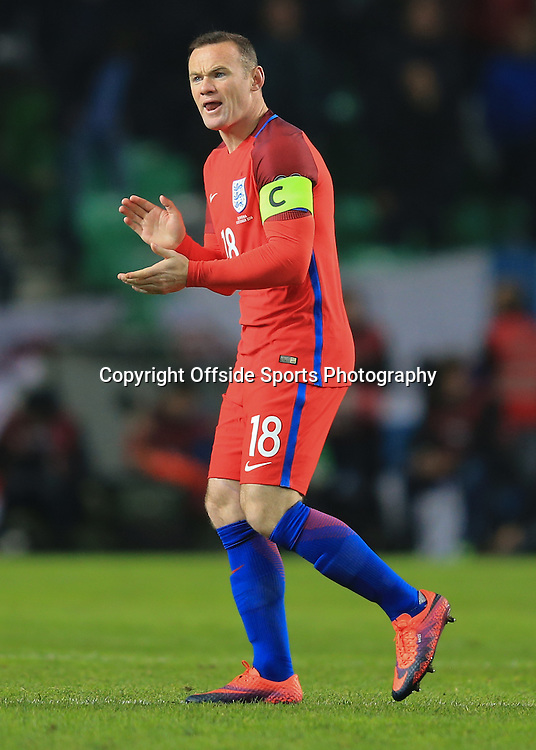 11 October 2016 - FIFA 2018 World Cup Qualifying (Group F) - Slovenia v England - Encouragement from Wayne Rooney of England after coming off the subs bench - Photo: Marc Atkins / Offside.