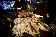 A vendor sorts fish at the Santinagar Market  in Dhaka, Bangladesh.