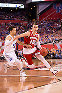 06 APR 2015:  Forward Sam Dekker (15) of the University of Wisconsin works the perimeter against Guard Tyus Jones (5) of Duke University during the championship game at the 2015 NCAA Men's DI Basketball Final Four in Indianapolis, IN. Duke defeated Wisconsin 68-63 to win the national title. Brett Wilhelm/NCAA Photos