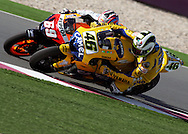 In an exciting finish, Italian Valentino pulls ahead of American Nicky Hayden will other a couple laps left in the Commercial Bank Grand Prix of Qatar, MOTO GP class, Losail International Circuit, 8 April 2006