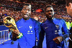 September 9, 2018 - Paris, France - Paul Pogba, Samuel Umtiti of France celebrate with the World Cup Trophy after the UEFA Nations League A group official match between France and Netherlands at Stade de France on September 9, 2018 in Paris, France. This is the first match of the French football team at the Stade de France since their victory in the final of the World Cup in Russia. (Credit Image: © Mehdi Taamallah/NurPhoto/ZUMA Press)