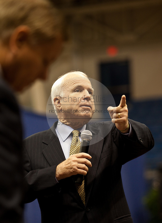 Senator John McCain (R-AZ) answers a question during a health care town hall meeting with as fellow Senator Lindsay Graham (R-SC) looks on September 14, 2009 at the Citadel in Charleston, SC.