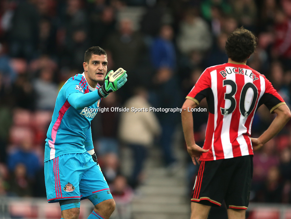 25 October 2014 Premier League Football Sunderland v Arsenal ; Sunderland goalkeeper Vito Mannone complains to his defender Will Buckley after Arsenal had been gifted a second goal.<br /> Photo: Mark Leech