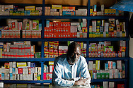 The owner of a pharmacy close to the local market in Ingore. Health facilities are scarce in this interior region of Guinea Bissau.