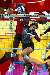 BLOOMINGTON, IL - September 28: Emmy Ogogor spikes on Rachel Maguireb during a college Women's volleyball match between the ISU Redbirds and the Southern Illinois Salukis on September 28 2019 at Illinois State University in Normal, IL. (Photo by Alan Look)
