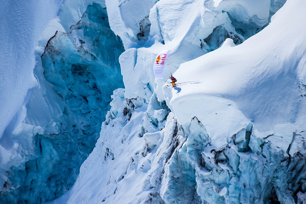 Jon Devore jumps off a large glacier while filming for the Unrideables in the Tordrillo Mountains near Anchorage, Alaska on April 24th, 2014.