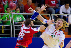 Robert Gunnarsson of Iceland vs Erlend Mamelund of Norway during handball match between Iceland and Norway in  2nd Round of Preliminary Round of 10th EHF European Handball Championship Serbia 2012, on January 18, 2012 in Millennium Center, Vrsac, Serbia. Iceland defeated Slovenia 34-32. (Photo By Vid Ponikvar / Sportida.com)