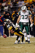 Pittsburgh Steelers wide receiver Emmanuel Sanders (88) falls backward after a wicked hit by New York Jets safety Eric Smith (33) that gets flagged as a personal foul unnecessary roughness penalty that gives the Steelers a first down in the second quarter during the NFL 2011 AFC Championship playoff football game on Sunday, January 23, 2011 in Pittsburgh, Pennsylvania. The Steelers won the game 24-19. (©Paul Anthony Spinelli)