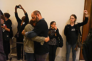 Ana Maria Archila,  co-director of the Center for Popular Democracy confronted Arizona Senator Jeff Flake in an elevator on September 28, 2018 to vote no on advancing Brett Kavanaugh to the Supreme Court. She is shown embracing a fellow activist as others are arrested on Monday September 24. Protesters wearing Believe Women T-shirts marched to stop the confirmation of Judge Brett M. Kavanaugh on Capitol Hill. The day ended with 128 arrests in the Russell Senate Office Building.