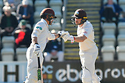 Rory Burns of Surrey and Mark Stoneman of Surrey touch gloves during the final day of the Specsavers County Champ Div 1 match between Worcestershire County Cricket Club and Surrey County Cricket Club at New Road, Worcester, United Kingdom on 13 September 2018.