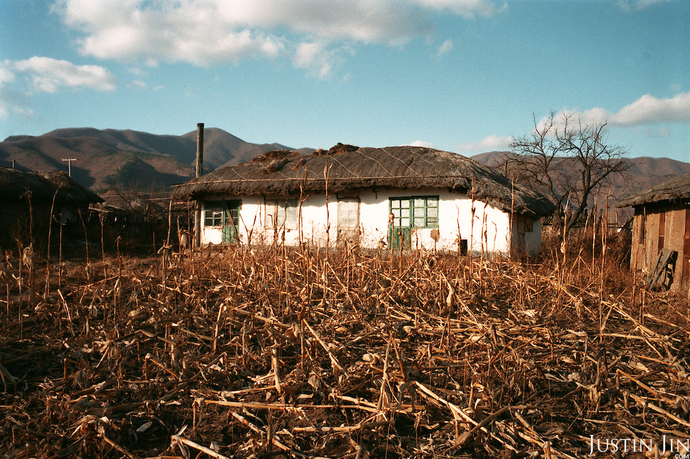 Northeastern China 11-2003..A hut in a Chinese village houses a North Korean refugee, kept by a Chinese farmer. North Korean women are smuggled and sold across the river border as wives, prostitutes and concubines on the promise of food and shelter. Some women are resold three or four times, each time for between 300 - 800 euros, depending on their age and looks...Ruled by the messianic leader Kim Il Sung and his son Kim Jong Il since 1948, North Korea has stubbornly stuck to its juche (self-reliance) ideology and siege mentality, imposing one Stalinist economic plan after another. Floods, droughts and mismanagement in the 1990s plunged the country into a preventable famine, killing up to three million, or 13 percent of the population. It now depends heavily on Chinese aid...China help North Korea fight the Korean War in the 1950s and continue to have a defence treaty with the Stalinist country...