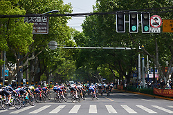 Race sweeps onto the main high street at Tour of Chongming Island 2018 - Stage 3, a 126.5 km road race on Chongming Island on April 28, 2018. Photo by Sean Robinson/Velofocus.com