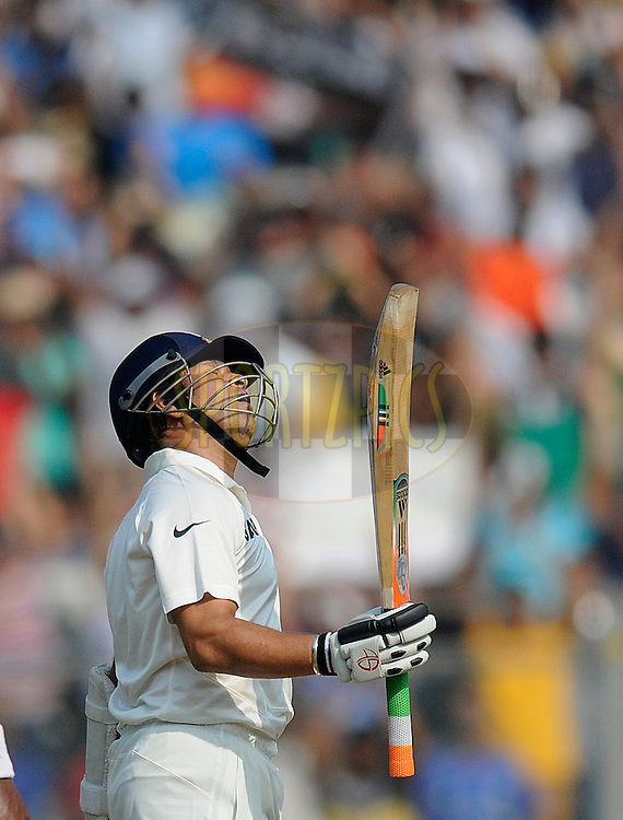 Sachin Tendulkar of India raises his bat after scoring a half century during day two of the second Star Sports test match between India and The West Indies held at The Wankhede Stadium in Mumbai, India on the 15th November 2013<br /> <br /> This test match is the 200th test match for Sachin Tendulkar and his last for India.  After a career spanning more than 24yrs Sachin is retiring from cricket and this test match is his last appearance on the field of play.<br /> <br /> <br /> Photo by: Pal PIllai - BCCI - SPORTZPICS<br /> <br /> Use of this image is subject to the terms and conditions as outlined by the BCCI. These terms can be found by following this link:<br /> <br /> http://sportzpics.photoshelter.com/gallery/BCCI-Image-Terms/G0000ahUVIIEBQ84/C0000whs75.ajndY