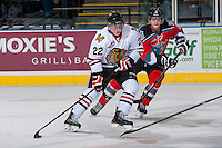 KELOWNA, CANADA - OCTOBER 4:  Alex Schoenborn #22 of the Portland Winterhawks is checked by Henrik Nyberg #21 of the Kelowna Rockets  at the Kelowna Rockets on October 4, 2013 at Prospera Place in Kelowna, British Columbia, Canada (Photo by Marissa Baecker/Shoot the Breeze) *** Local Caption ***