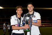 Bolton's goal scorers Bolton's U23 Stephen McKenna (L) and Bolton's U23 Dennis Politic (R) with the winners trophy during the U23 Professional Development League Play-Off Final match between Nottingham Forest and Bolton Wanderers at the City Ground, Nottingham, England on 4 May 2018. Picture by Jon Hobley.