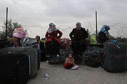 61014161<br /> Palestinians wait to enter Egypt through the Rafah border crossing in the southern Gaza Strip on Feb. 4, 2014. Egypt on Tuesday reopened its border with the Gaza Strip after keeping the Palestinian enclave s only prime gate to the outside world shut for 12 days, Gaza Strip, Tuesday, 4th February 2014. Picture by  imago / i-Images<br /> UK ONLY