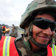October 17, 2008 -- GULFPORT, Miss. -- U.S. Navy Equipment Operator Jose Torres posts as a road guard while his platoon crosses the road behind him.  Constructionman Torres is attending Expeditionary Combat Skills School (ECS).  .The ECS school is designed to build a basic level of battlefield competence for sailors from the Navy's newly formed Expeditionary Combat  Combat Command  (NECC) community. The students have a wide range of precision modern warfare skills. Because the Navy is supporting missions ashore more than ever, there is a significant need for sailors to gain land-based combat skills. The aim of the school is to provide NECC sailors basic warfighting and survival capabilities. Photo by Mass Communication Specialist 1st Class Roger S. Duncan.  (RELEASED)