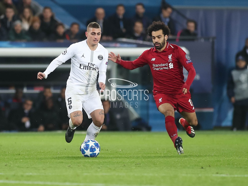 Mohamed Sarah of Liverpool against 	Marco Verratti of Paris Saint-Germain during the Champions League group stage match between Paris Saint-Germain and Liverpool at Parc des Princes, Paris, France on 28 November 2018.