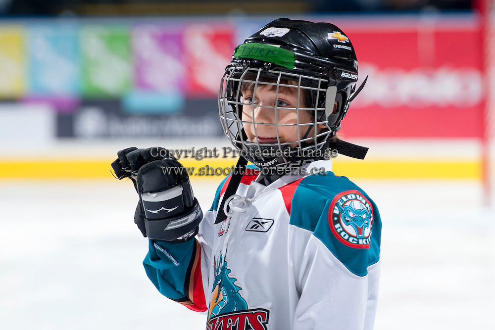 KELOWNA, CANADA - NOVEMBER 30: The Pepsi Save On Foods player of the game waves to the crowd as the Kelowna Rockets play the Kamloops Blazers on November 30, 2013 at Prospera Place in Kelowna, British Columbia, Canada.   (Photo by Marissa Baecker/Shoot the Breeze)  ***  Local Caption  ***