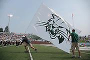 Alumni running with the Bobcat Flag