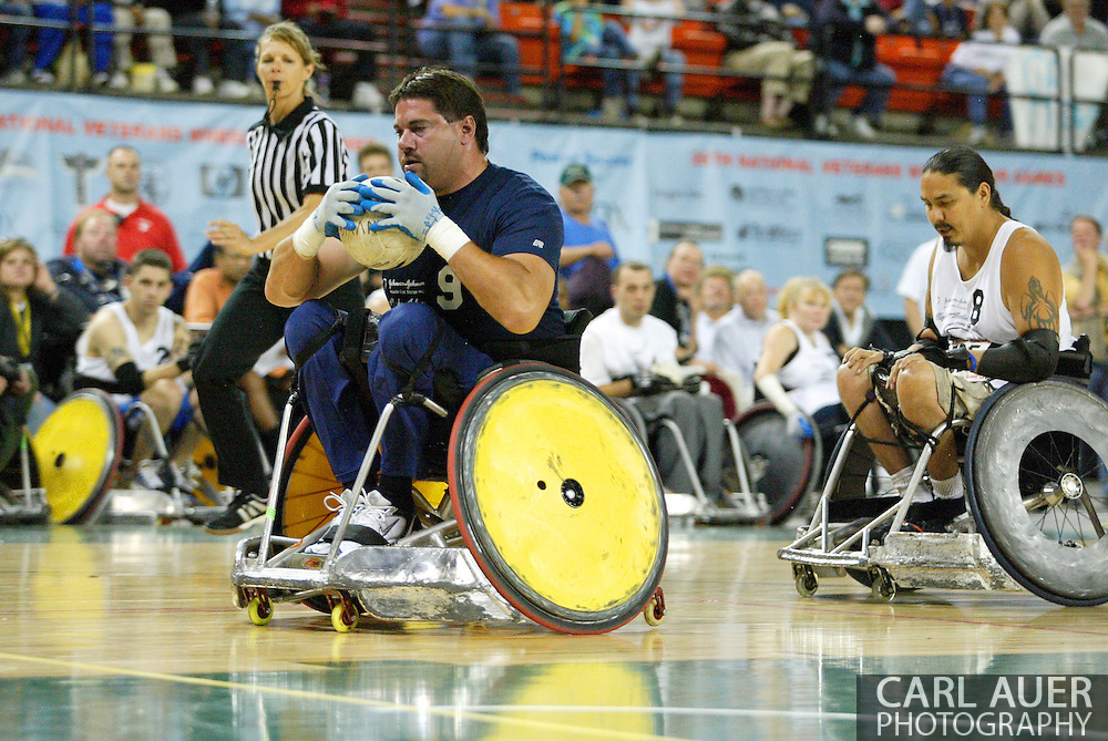 July 7th, 2006: Anchorage, AK - Scot Severn (9) scores as White defeated Blue in the gold medal game of Quad Rugby at the 26th National Veterans Wheelchair Games.