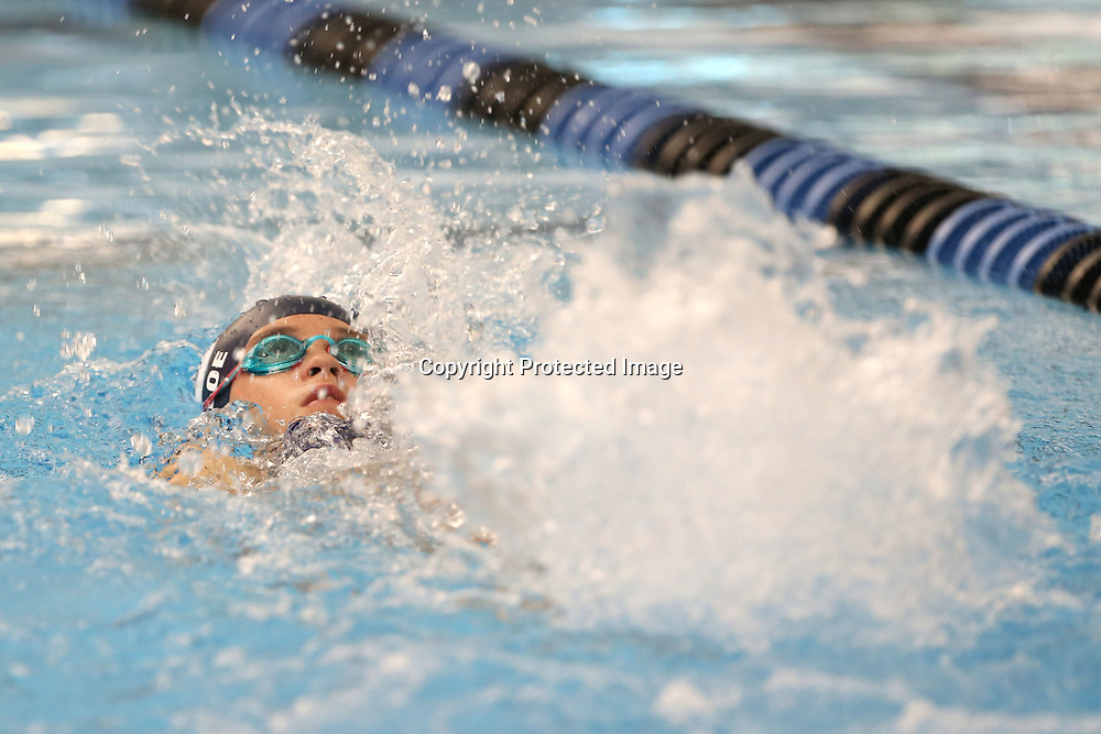 Chloe Frandsen, 11, from Collierville Tennessee, swims the 100 meter backstroke at the John Servati Memorial Swim Meet at the Tupelo Aquatic Center Friday morning.