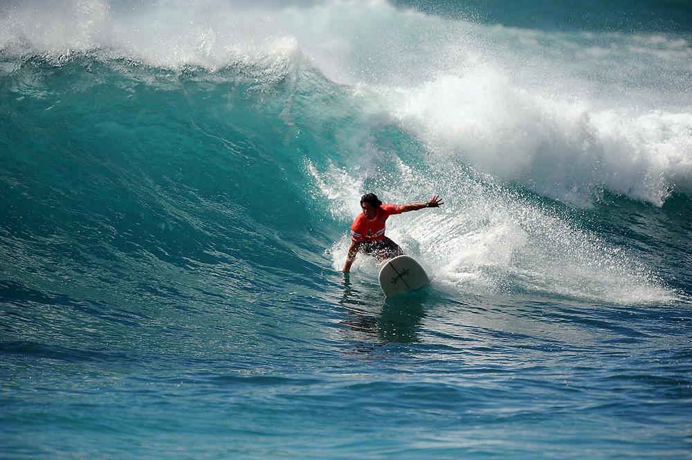 November 4th 2010: Rusty Keaulana drives off the bottom during his semi final of the ASP World Longboard Championship at Makaha Oahu-Hawaii. Photo by Matt Roberts/mattrIMAGES.com.au