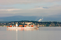 Container ship making way through Admiralty Inlet Washington USA