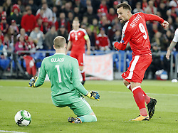 BASEL, Oct. 8, 2017  Switzerland's Haris Seferovic (R) shoots past Hungary's goalkeeper Peter Gulacsi during the FIFA World Cup 2018 Qualifiers Group B match between Switzerland and Hungary in Basel, Switzerland, Oct. 7, 2017. Switzerland won 5-2. (Credit Image: © Ruben Sprich/Xinhua via ZUMA Wire)